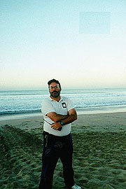 Dr. Frank Paladino standing by leatherback tracks